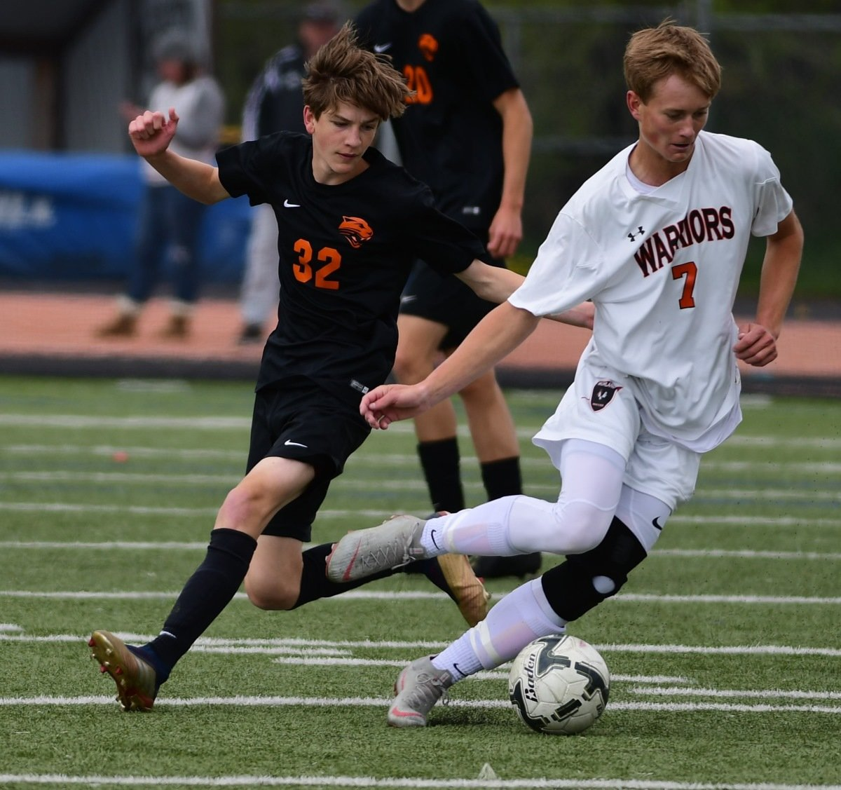 Panther midfielder Garrett Morris (left) makes a break for the ball with Worland's Wyatt Wyman during Saturday's championship game in Jackson.