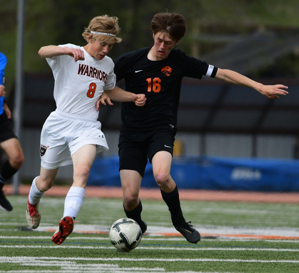 PHS sophomore Sam Bauer (right) battles Worland's Daniel Weyrich for possession of the ball during Saturday's 3A State Championship game in Jackson. The Warriors won the contest 2-0 to cap an undefeated season.