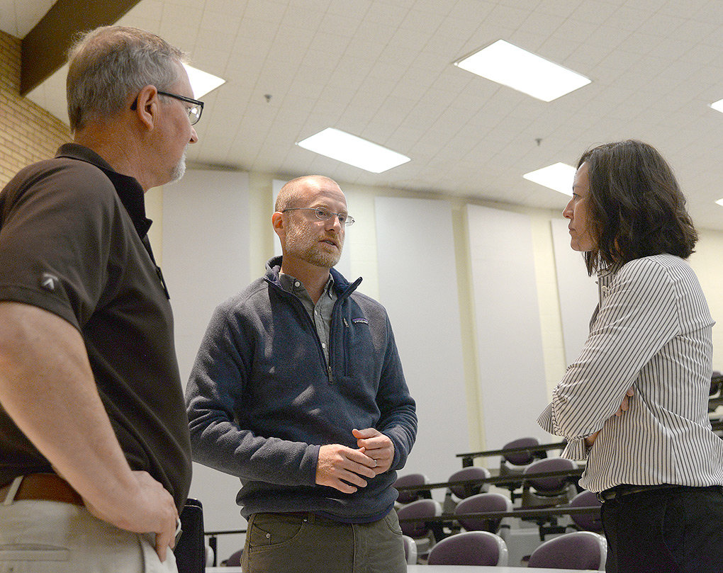 FCC Commissioner Brendan Carr visits with Bruce Morse of the Wyoming Small Business Development Center and Christine Bekes of Powell Economic Partnership following a Thursday talk at Northwest College.
