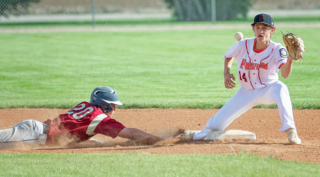 Billings Halo Hunter Morse (No. 20) slides safely back to second ahead of a pick-off throw to Pioneers shortstop Nate Brown Monday at Ed Lynn Memorial Field. The Pioneers split a doubleheader with the Halos, dropping the first game 7-5, but rebounding to win the nightcap 7-1.