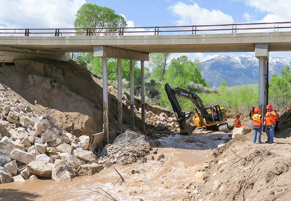 Crews work to make repairs on the Pat O'Hara Creek bridge on the Chief Joseph Scenic Highway. WYDOT Cody heavy equipment operator Shaun Emmett of Cody is operating the excavator. The road remains open for residents and travelers.