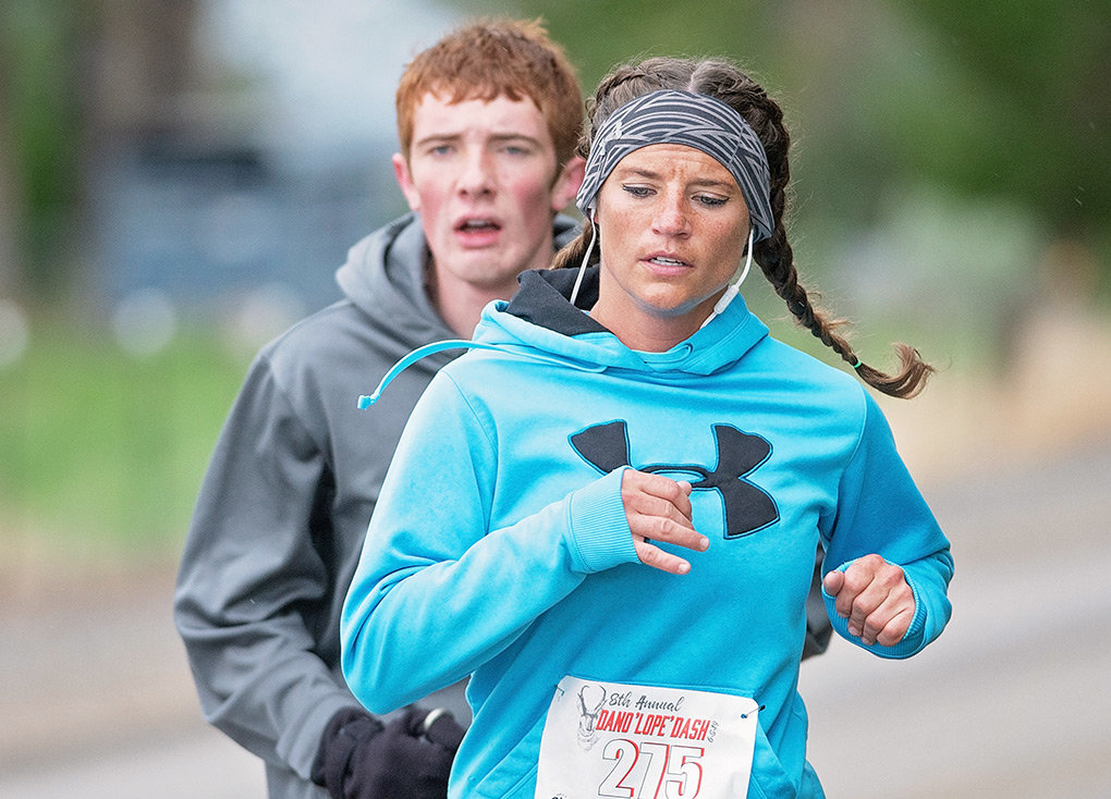 Kelsey Scolari (front) and Dylan McEvoy participate in the Dano'lope' Dash Saturday.
