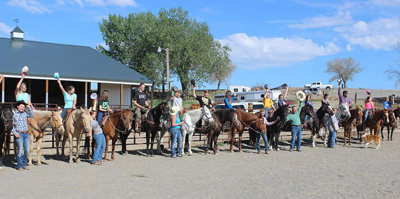 Participants in Camp Wannabe pose for a photo earlier this month. The camp, held in rural Powell, provides local youth an opportunity to learn the basics of horsemanship.