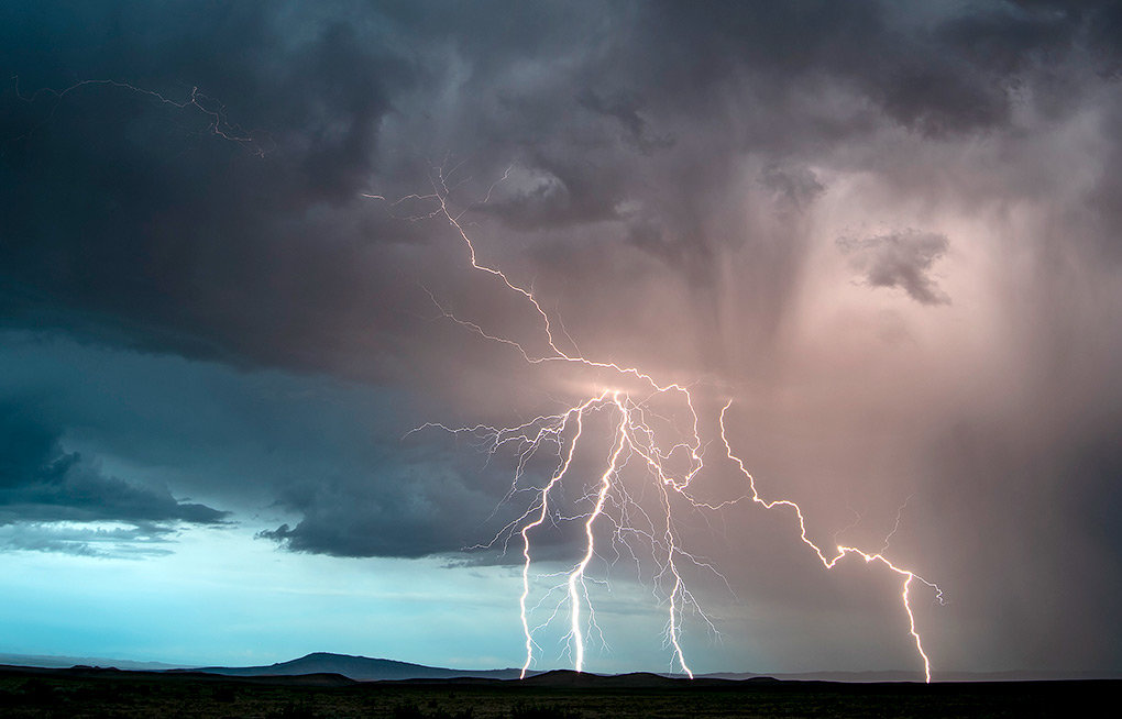 Lightning splits the sky just north of Cowley on the evening of  July 4. To many residents' dismay, rain and thunderstorms have continued in July, following significant rainfall in May and June. Cooler weather last week slowed the rise of water at Buffalo Bill Reservoir.