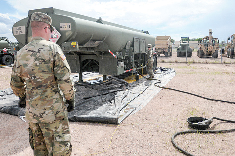 Spc. Jonathan Richards and Pvt. Annabelle Mowery of the Powell-based Headquarters Service Company, 960th Brigade Service Battalion, Wyoming Army National Guard, coordinate the fueling of several trucks using a 5,000-gallon tanker during annual training at Camp Guernsey in June.