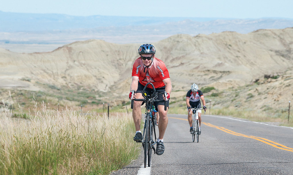 Riders climb Mormon Hill out of Little Sand Coulee in the Badger Basin on their way to Powell Wednesday. About 350 riders overnighted in Powell while touring the area with the 23rd Tour de Wyoming.