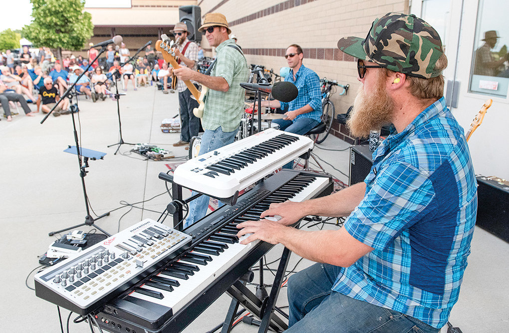 Aaron Davis and the Mystery Machine play for Tour de Wyoming riders.