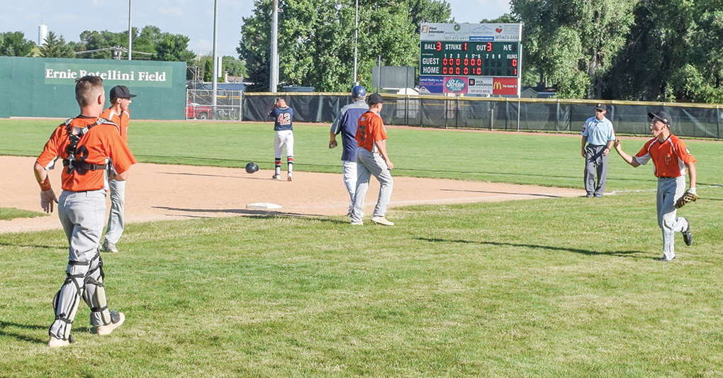 Powell Pioneers B team members (from left) Jhett Schwahn, Cade Queen, Brock Johnson and Ryan Cordes celebrate after closing out a 1-0 win over Cheyenne at the Wyoming Legion Baseball Class B State Tournament on Friday. The Pioneers went on to take the silver medal.
