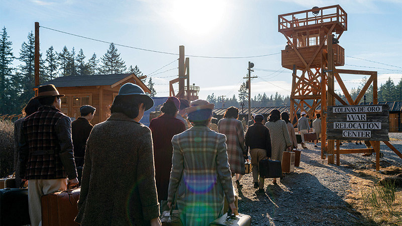 This scene from the set of AMC's 'The Terror: Infamy' shows Japanese American incarcerees as they arrive at the show's fictional confinement site in Oregon.