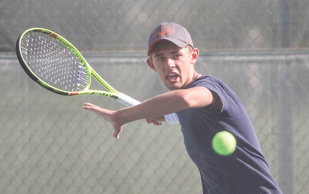 Powell High School tennis player Jesse Brown, last year's No. 1 singles player, returns a serve during a Tuesday morning practice at the PHS courts. Brown and his teammates open the 2019 season Monday at home against Green River.