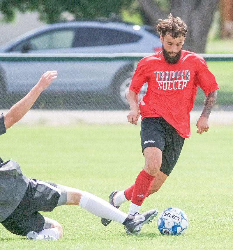 NWC midfielder Pedro Gallardo brings the ball up the pitch during a recent scrimmage against North Idaho College. The Trappers will host NWC alumni this Saturday in an intrasquad scrimmage.