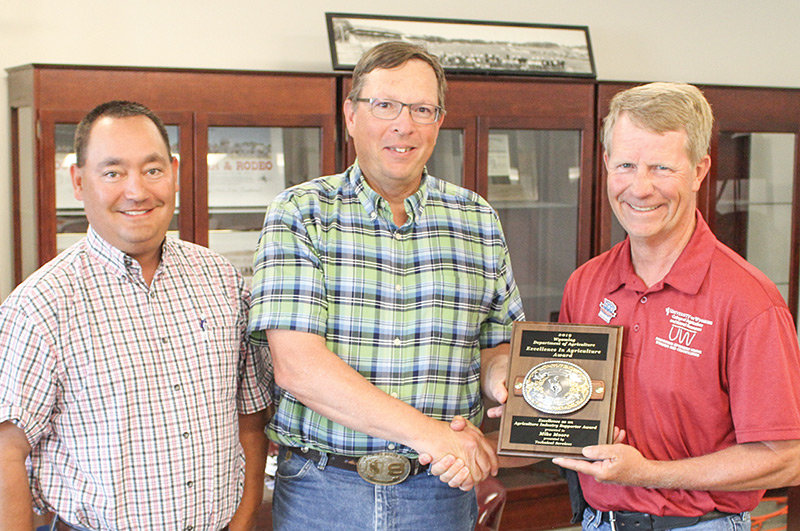 Mike Moore of Powell (at right) was among five people recognized by the Wyoming Department of Agriculture for supporting agriculture in the state. He's pictured alongside Wyoming Department of Agriculture Director Doug Miyamoto (at left) and Kent Drake, the manager of the department's Technical Services Division.