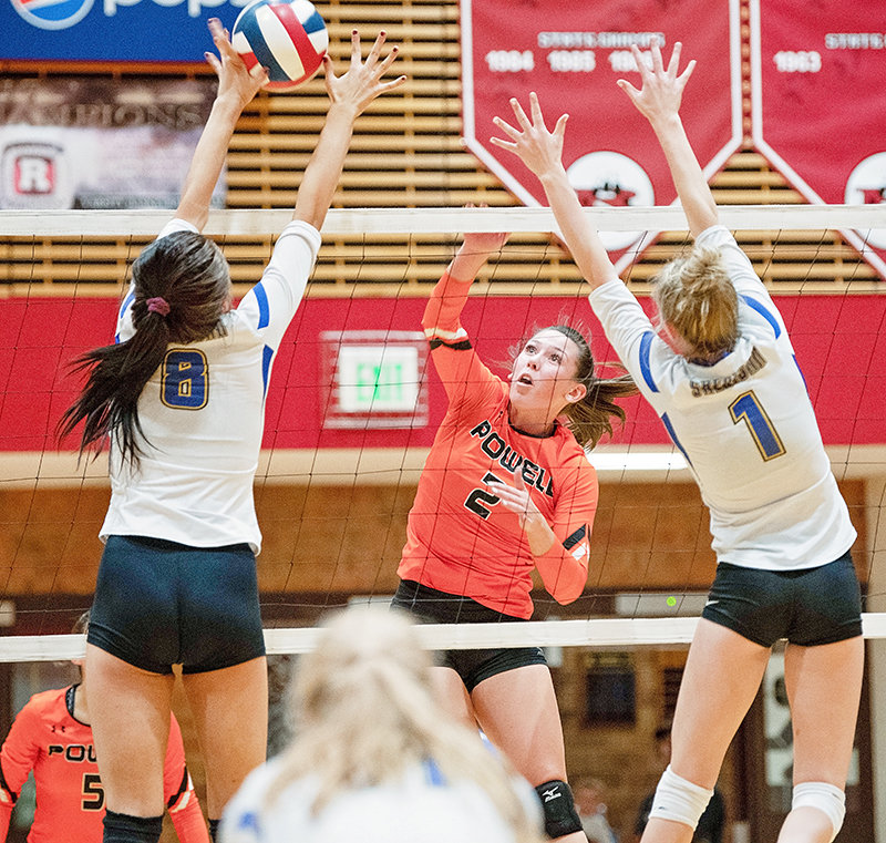 PHS volleyball player Kady Wells spikes the ball past a pair of Sheridan defenders Friday at the Riverton Invitational. The Lady Panthers won the contest in three sets, 21-17, 13-21, 15-14.