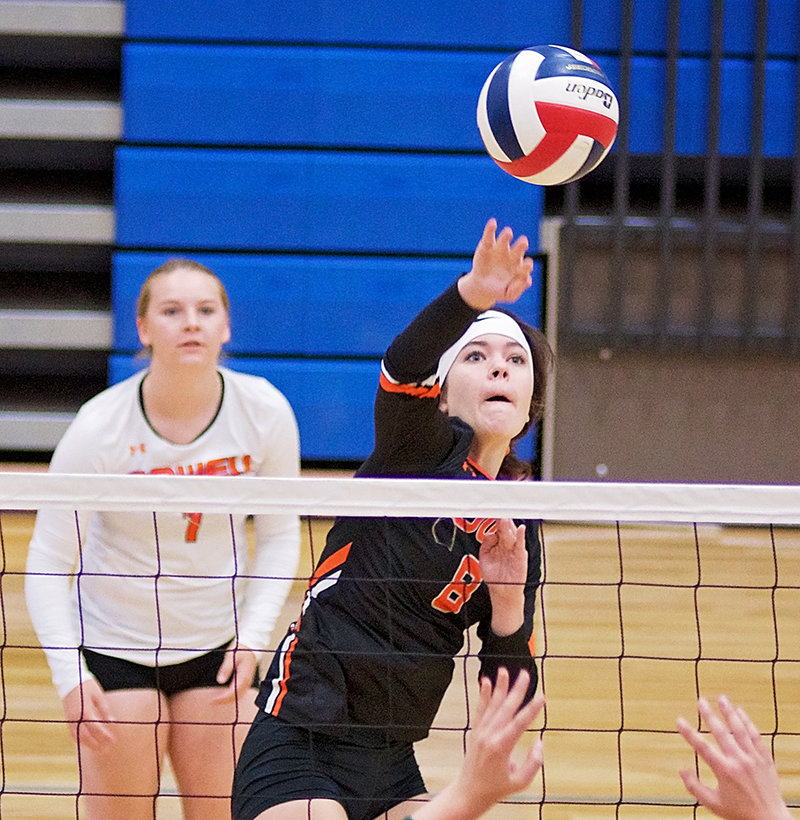 PHS middle hitter Mattie Larsen spikes the ball against Billins Central Saturday as libero Michele Wagner looks on at the MT/WY Border War Tournament in Cody. The Lady Panthers finished 2-2 for the tournament.