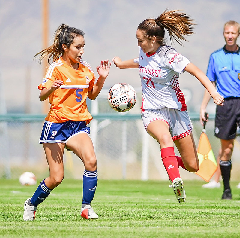 Lady Trapper and Powell native Jalie Timmons, right, battles TVCC's Celeena Cisneros for the ball during a game last month at Trapper Field. The NWC women's soccer team is 2-3 on the season, the team's best start in years.