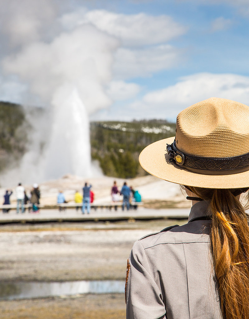 Two tourists were recently charged after getting too close to the iconic Old Faithful geyser in Yellowstone. A ranger is pictured at Old Faithful in this 2014 photo.