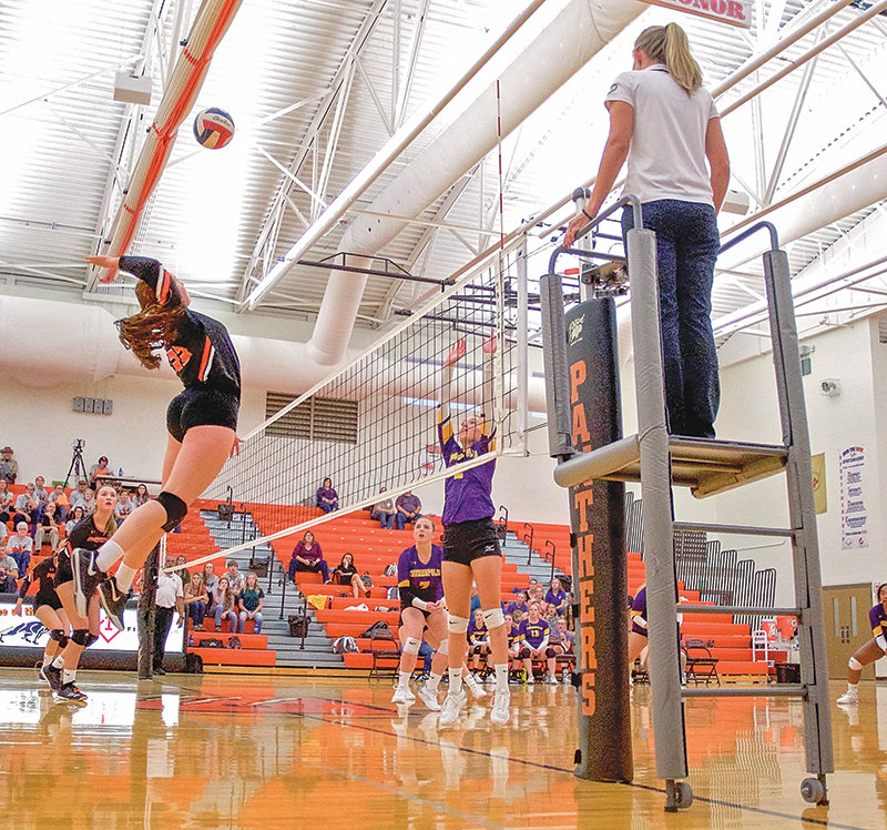 PHS Lady Panther Paije Johnson goes up for a spike against Thermopolis in Powell's Sept. 12 home opener. The Lady Panthers lost the match 3-1.