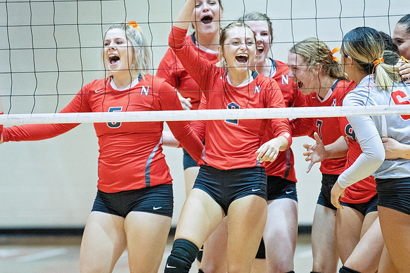 Members of the NWC volleyball team celebrate after winning a home-opening 3-2 nailbiter over Miles Community College earlier this month. It was the first win on the season for the Lady Trappers, who are now 2-9.