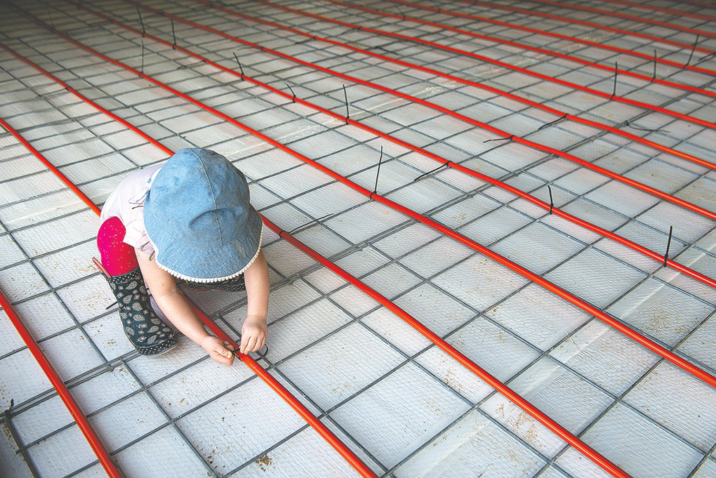 Scarlett Wood, daughter of Pat and Sara Wood, attempts to help her parents with the construction on a special heated floor in their facility. It's being prepared for traditional floor malting.