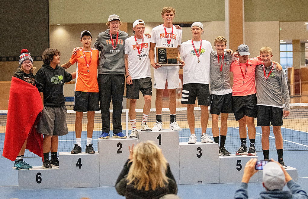 The PHS boys' tennis team poses on the podium with their state champion plaque. The Panthers won two individual events and posted two seconds and a fourth in the remaining three to claim the overall title. From left: Aiden Chandler, Kolt Flores, Ethan Bartholomew, Grant Dillivan, Aidan Jacobsen, Jesse Brown, Dylan Preator, Jay Cox, Justin Vanderbeek and Logan Brown.