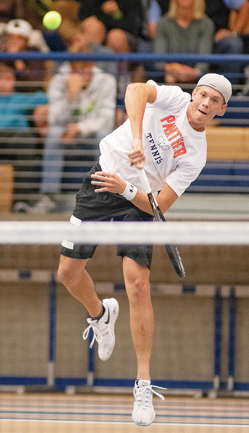 PHS tennis player Dylan Preator serves to Campbell County's Tanner Lemm in the No. 2 singles state championship match in Gillette Saturday. Preator defended his title with a 6-0, 3-6, 6-4 win, helping the Panthers take the overall team title.