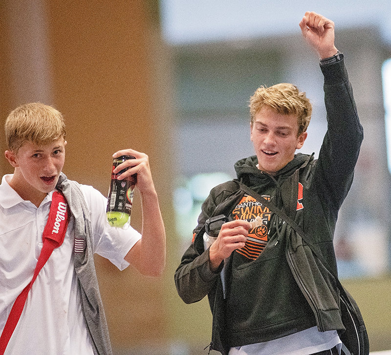 Powell's Logan Brown, left, and Jay Cox celebrate their state championship in No. 3 doubles Saturday at the Wyoming State Tennis Tournament in Gillette.