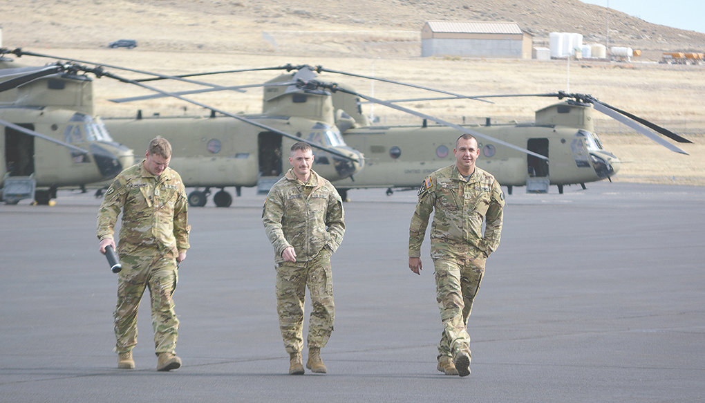 A group of Chinook helicopters with the Montana Army National Guard refueled at Yellowstone Regional Airport on Saturday because Cody is pilot J.D. Nose's hometown. Nose, pictured at right, and his fellow soldiers are being deployed overseas and received a big sendoff in Cody.