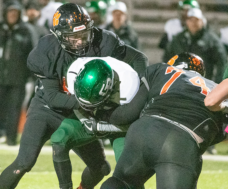 PHS defensive lineman Seth Horton, left, and Bryce Johnson combine for a sack on Green River's quarterback during a game earlier this month at Panther Stadium. The Panthers are at Lander Friday for the opening round of the 3A State Football Tournament.