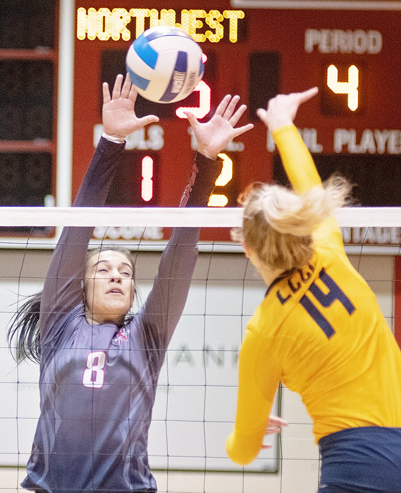 NWC outside hitter Eirini Matsouka attempts a block on Laramie County Community College's Cassidy Nelson during Saturday's match at Cabre Gym. The Lady Trappers dropped their regular-season finale to the Golden Eagles 3-2.
