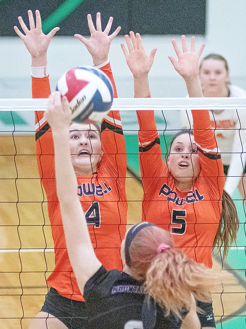 PHS volleyball players Gabby Harshman (No. 4) and Sabrina Shoopman (No. 5) go up for a block against Mountain View Friday in the opening round of the 3A West Regional Tournament in Lander. The Lady Panthers finished 1-2 for the tournament.