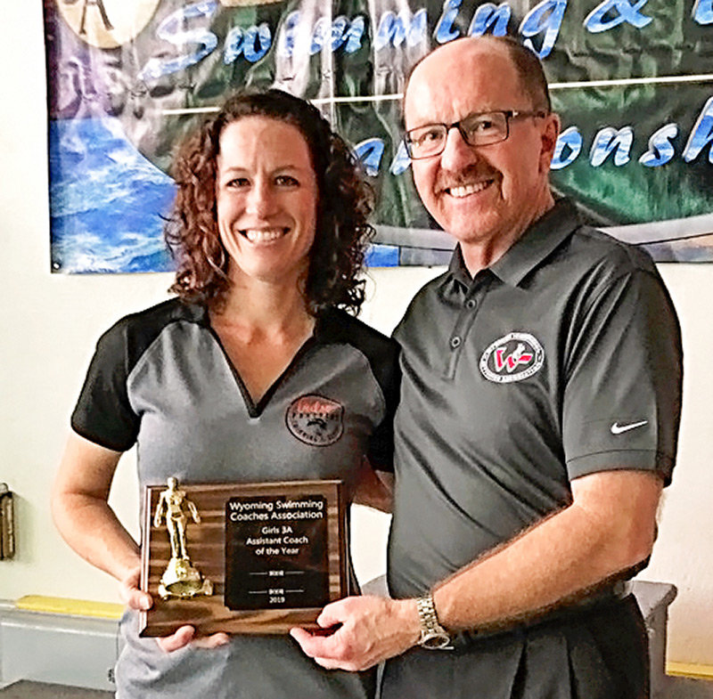 PHS diving coach Heather Christensen is all smiles after being named the 3A Assistant Coach of the Year at last week's State Swimming and Diving Championships in Gillette. WHSAA commissioner and former PHS coach Ron Laird presented Christensen with the award.