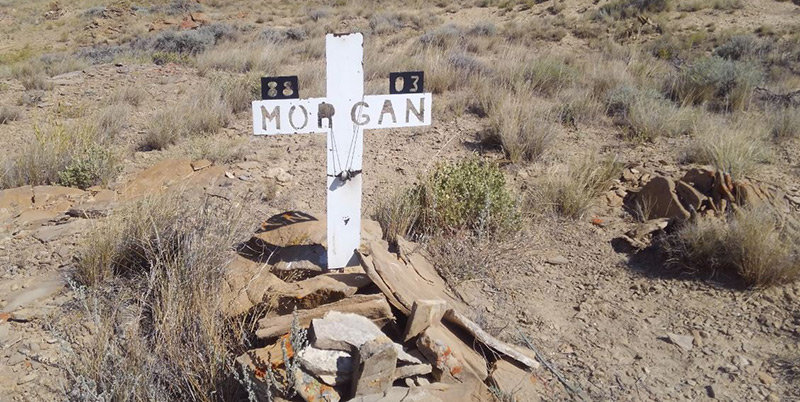 The Park County Sheriff's Office says a pet was buried in this unusual grave, found by a landowner over the summer on Polecat Bench. As for the cross and rings, the sheriff's office says those who created the grave and memorial do not want the items' significance made public.
