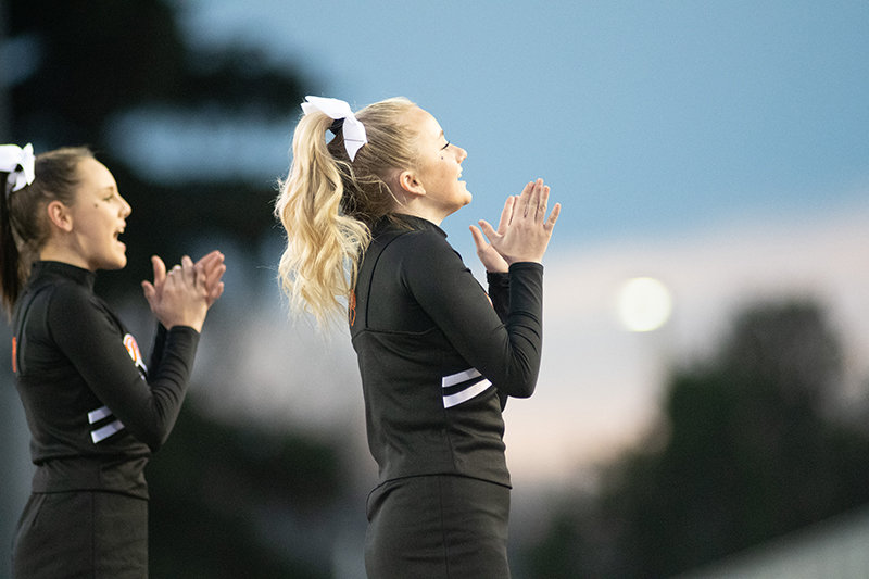 Morgan Schmidt (at right) and Vanessa Richardson cheer on the Panther football team during the Class 3A championship game in Laramie. The Powell High School cheerleaders entered the 7220 Game Day Spirit Competition the following day, placing third among 3A teams.