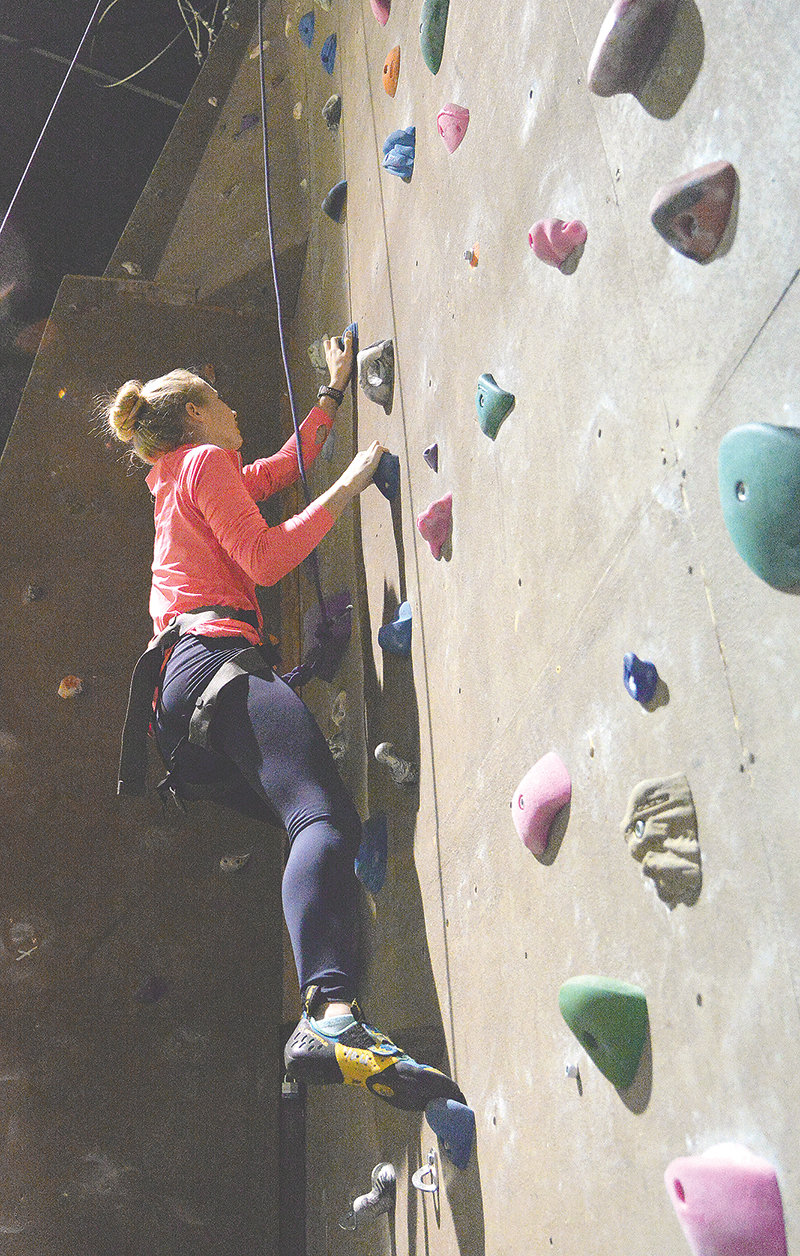 Cody High School student Ellie Osborne practices climbing at Northwest College's climbing wall. Osborne is among the students in the school's Outdoor Club, which has partnered with NWC's outdoor program.