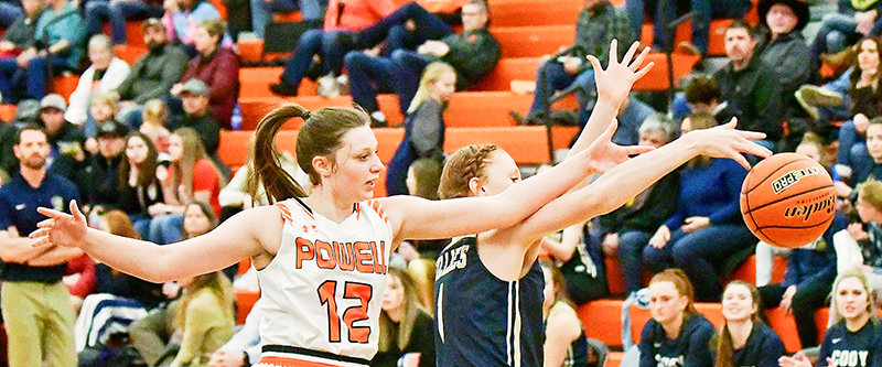 Powell senior Sidney O'Brien and Cody freshman Allison Boysen struggle for possession of the ball in Friday night's game in the Panther Gym. The Fillies won the squads' second meeting of the season, 43-16.
