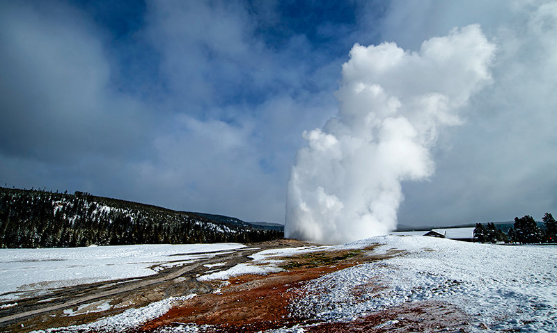 Yellowstone National Park's Old Faithful geyser erupts in late December. Two men were recently sentenced to jail time and banned from the park for five years for trespassing on the cone of the geyser in September.