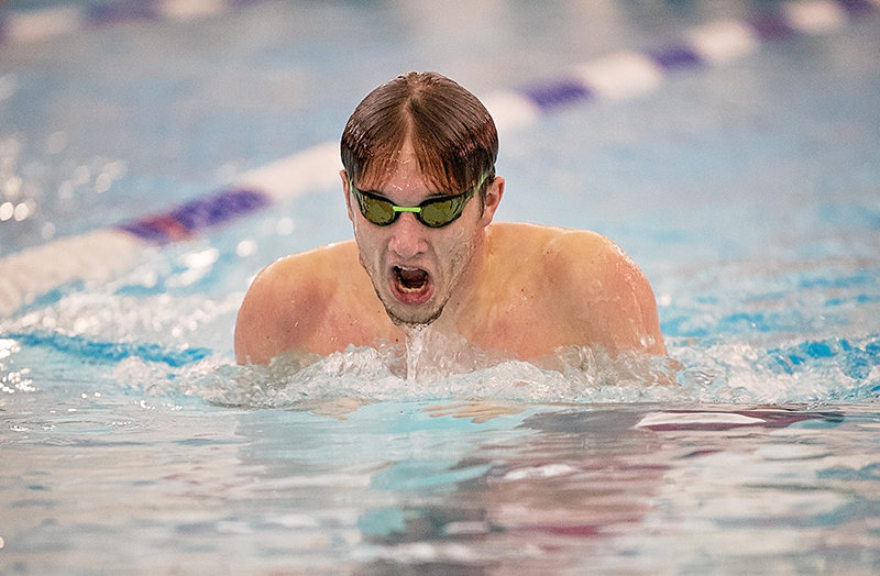 Richard Spann swims the breaststroke during the 200 individual medley during a Friday dual against Lander. Spann placed second in the event with a time of 2:15.67.