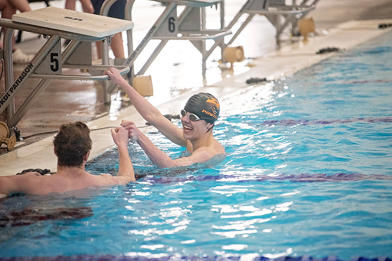 After coming in a close second in the 500 free, Nate Johnston gives a congratulatory fist bump and smile to Lander's Brayden Brown.