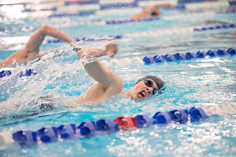 Kyler Warren swims to a state-qualifying time in the 500 freestyle at the Powell Aquatic Center on Friday. Warren became Powell's 14th state qualifier, also qualifying in the 200 IM.