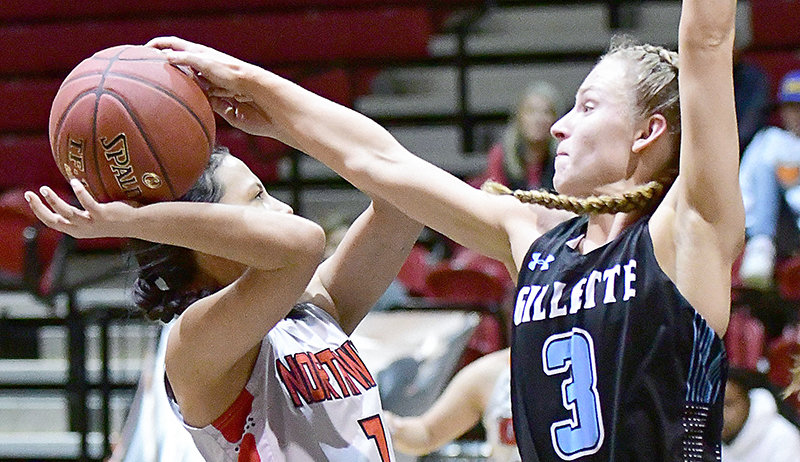 Kendall Wright of Greybull (left) is blocked by Gillette Pronghorn Skylar Patton in Saturday's game in Cabre Gym at Northwest College. Gillette took the win, 64-47.