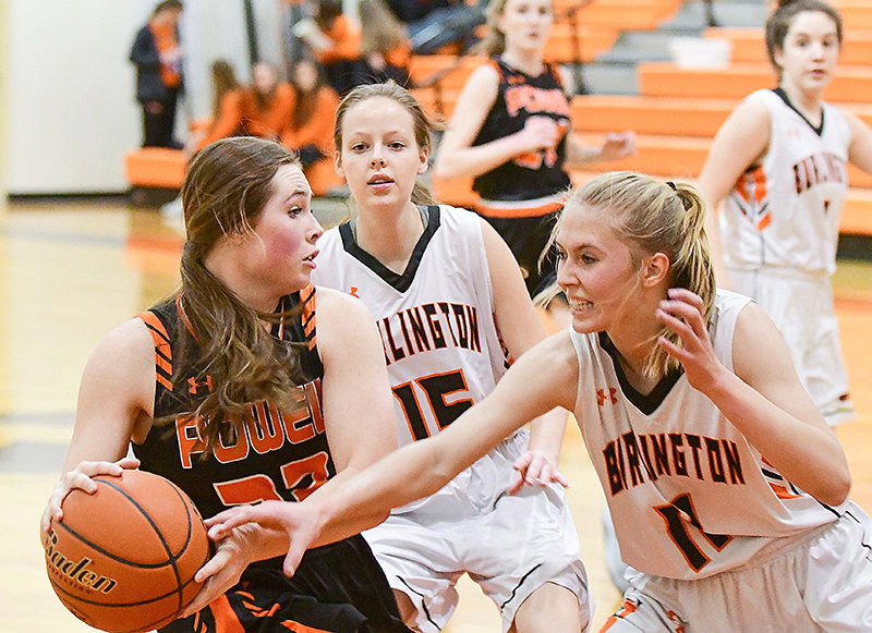 Panther Paije Johnson, shown fighting off Burlington defenders Victoria Nelson (right) and Vivian Allen (15), was a warrior in the paint Tuesday night at Burlington. Johnson shared game-high scoring honors, putting up 12 points in Powell's 35-24 victory.