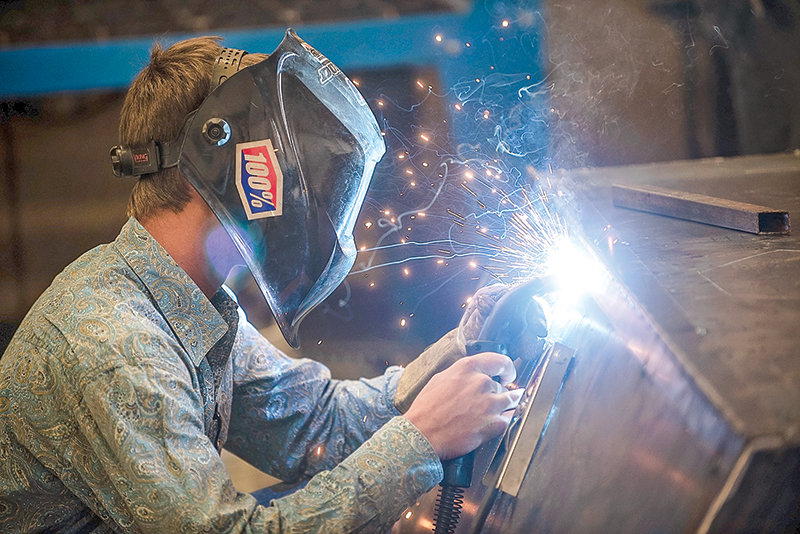 A Powell High School student works on a welding project in this file photo. While the Powell school district is committed to continuing its support for career and technical education — such as welding, wood shop, culinary arts and agriculture — the district may no longer seek some federal funding for CTE, due to new regulations.