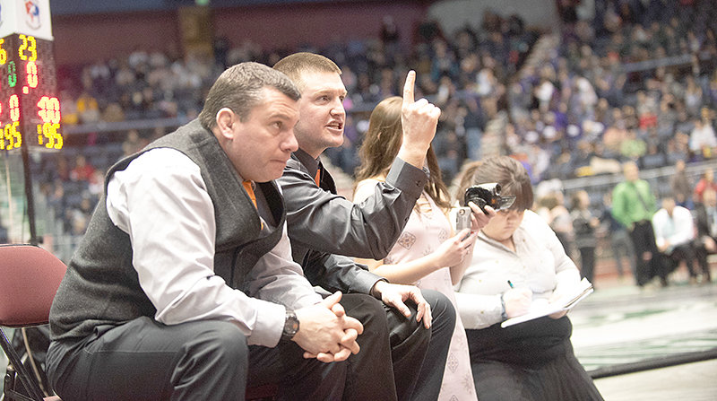 Nick Fulton, seen alongside longtime head coach Nate Urbach at the 2019 State Wrestling Championships, was named the new head coach of the Powell High School wrestling team on Wednesday.