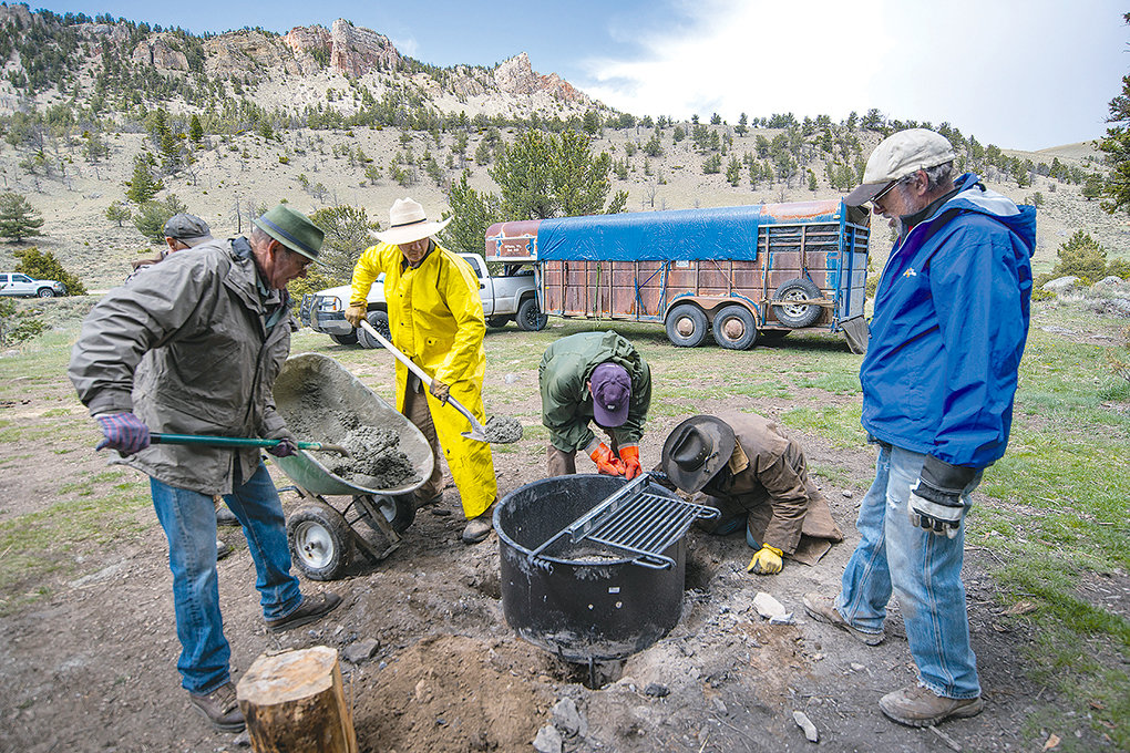 Shoshone Back Country Horsemen members Jim Hanchett, Frank Fagan, Walter Haslett, Dale Olson and Bud Melcher work to install a fire ring at Dead Indian Campground in the Shoshone National Forest earlier this month.