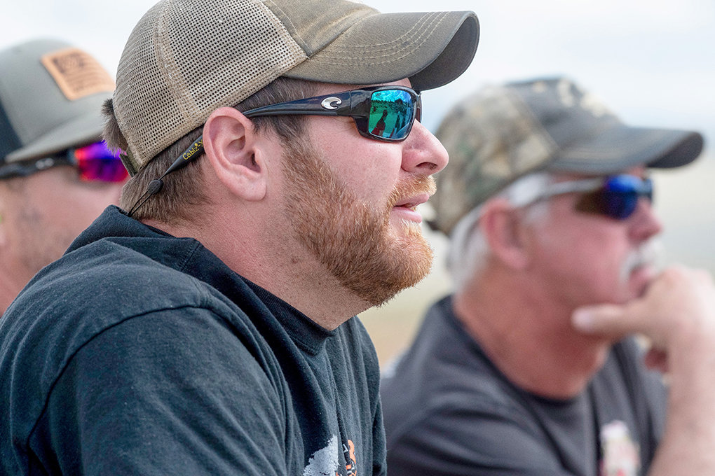 Josh Lancaster, executive director of Polestar Outdoors of Powell, watches his team perform during a competition in Cody last week. Lancaster was competitive in high school and college in shooting sports and earned a ministry degree to Liberty University prior to coming to Powell.