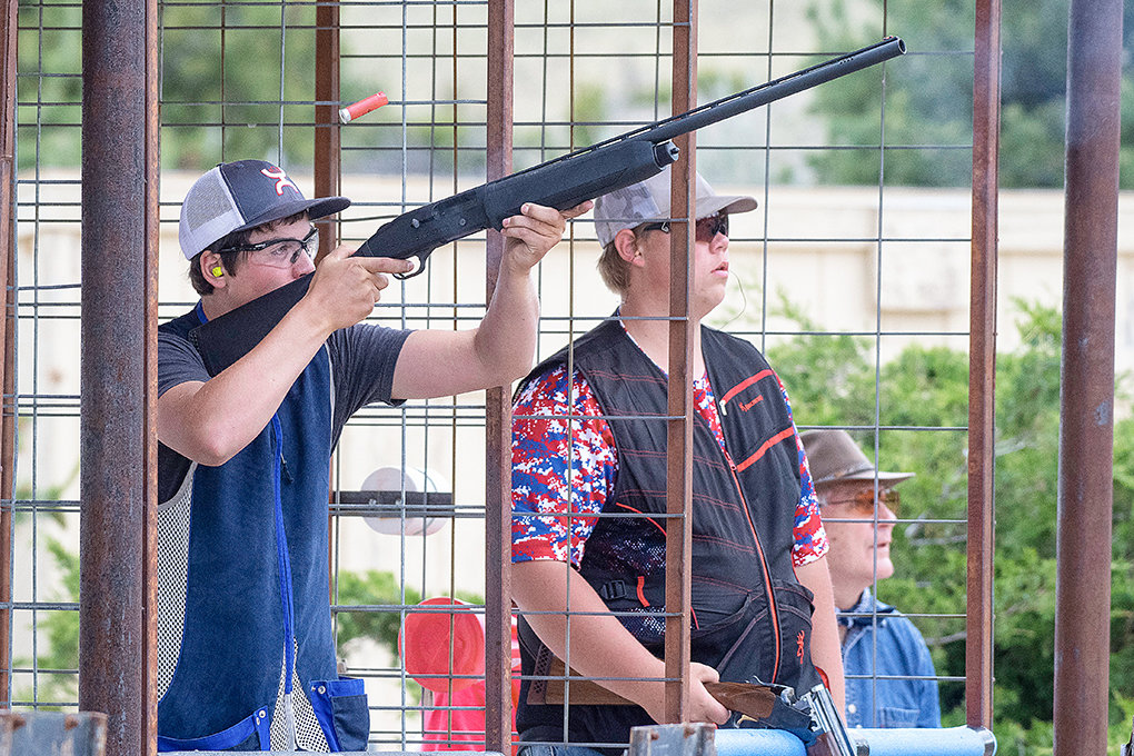 Powell's Garret Tharp takes a shot next to Jace Nordeen (at left) during the 5-stand competition at the Cody Shooting Complex on Friday. Nordeen, a junior at Powell High School, placed third in 5-stand and trap.