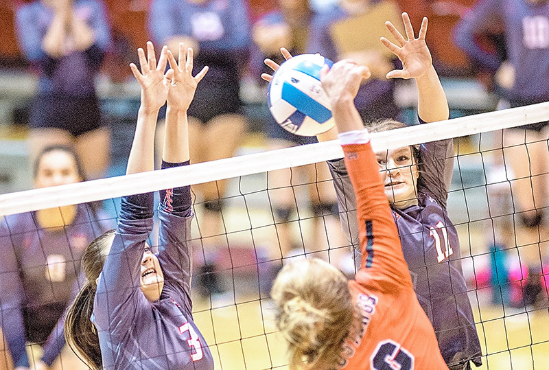 Trapper Mollee Krum at right, blocks a hit last season as Caitlyn Costa assists. Northwest College student-athletes may be able to return to campus next month, with the start of the NJCAA's fall season set for Aug. 20.