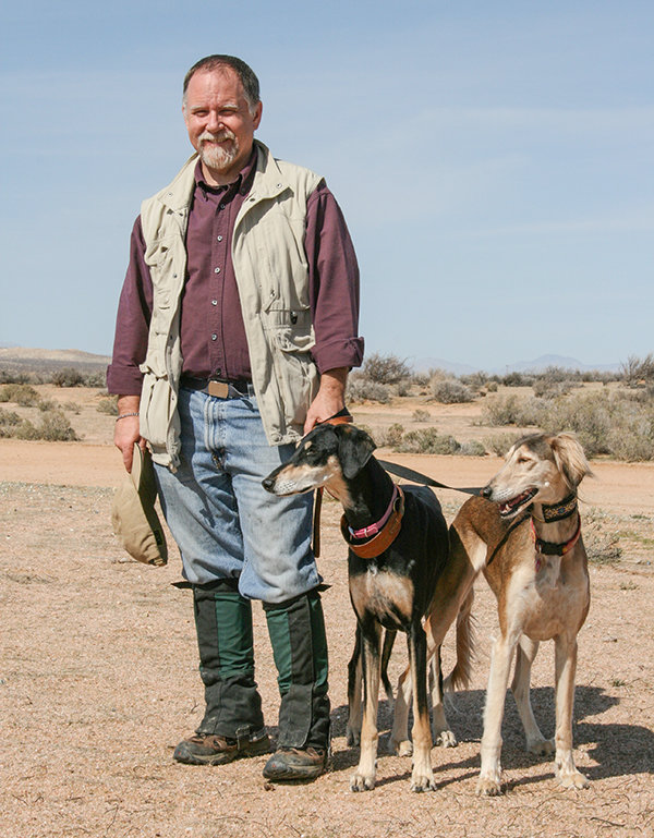 Canine historian Brian Patrick Duggan is pictured with his Salukis, Telek and India.