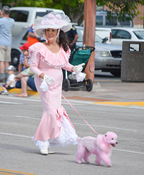 Always a crowd favorite, Hope Sheets, known as 'The Pink Lady,' returned to the 2020 parade with her pink poodle.