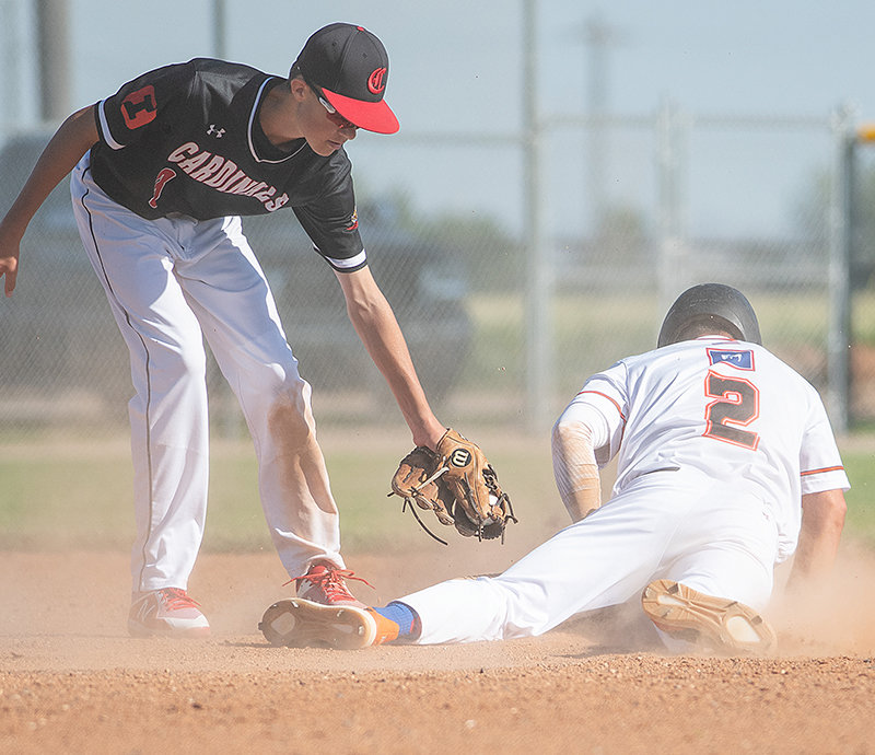 Colin Queen avoids a tag at second base after stealing in game one of Friday's doubleheader against Billings. The Pioneers lost the game 13-0.